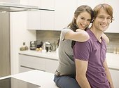 Couple posing in kitchen