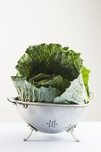 Cabbage leaves in a colander.