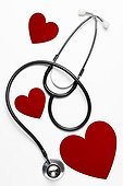 Stethoscope and red heart shapes.