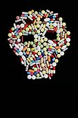 Pills and tablets in the shape of a skull.