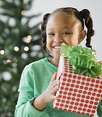 African American girl holding Christmas gift