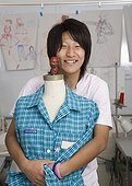 Japanese fashion design student with dressmakers model