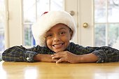 African boy wearing Santa hat