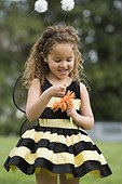 Mixed race girl in bumble bee costume