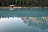 Canada, Alberta, Banff, Mountain and forest reflected in calm Lake Louise