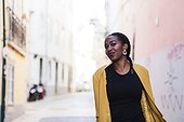 Portugal, Lisbon, Smiling young woman in old town