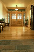 Tile and Wood Floors in Foyer
