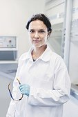 Portrait of confident female scientist standing at laboratory