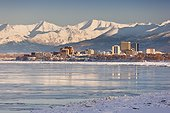 View of Anchorage skyline, Chugach Mountains and Cook Inlet from Earthquake Park, Southcentral Alaska, Winter
