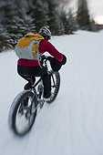 Woman riding a Fatback snow bike, Hillside trails, Anchorage, Southcentral Alaska, Winter