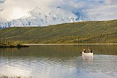 Mature couple canoeing in Wonder Lake, Denali National Park & Preserve, Interior Alaska, Summer