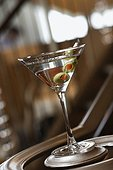 Martini With Olives on Banister
