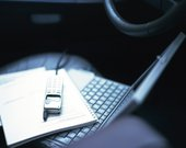 Notebook and mobile phone on laptop in the car, high angle view
