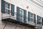 Black Shutters and Iron Balcony