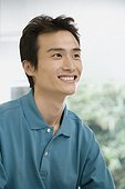 Close-up of a male office worker smiling