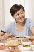 Mid adult woman having food and smiling