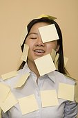 Close-up of a businesswoman covered with adhesive notes