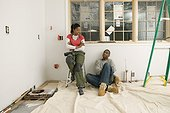 Carpenters resting in unfinished room