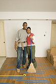 Couple standing on unfinished wood floor