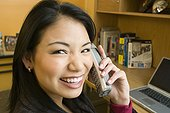 Woman talking on cordless phone