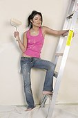 Woman standing on stepladder