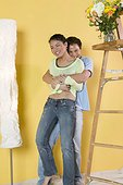 Couple hugging in unfinished room