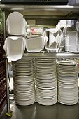 Empty plates and take-out cartons in restaurant