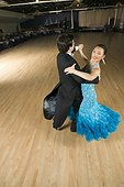 Professional dancers practicing in ballroom