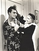 Angry woman pulling man's hair