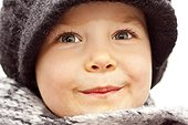 Toddler wearing wooly hat and scarf