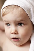 Little girl with towel around her head