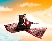 Business man flies on magic carpet