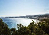 panoramic late afternoon view of old town Nice, French Riviera, with beach, promenade, and coast