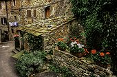 The courtyard of an historic stone building, a family home, in a small village in Tuscany