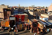 View over roofs of the city carpets hang at facades Place Rahba Qedima Medina Marrakech Morocco