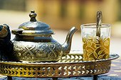 Glass with mint tea and silver teapot, Morocco, Africa