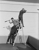 Men standing on ladder with binoculars and telescope