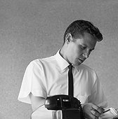 Businessman looking at telephone diary