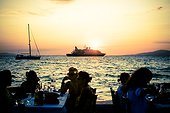 Mykonos town, Little Venice. People dining out at sunset (Mikonos island, Mykonos, Cyclades, Cyclades, Greece)