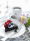 Piece of cake with berries on plate