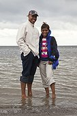 Portrait of couple wading in sea