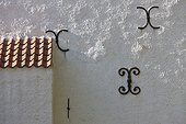 Iron decorations on house wall