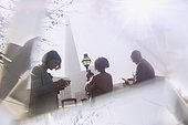 Business people using cell phones in sunny city, London, UK