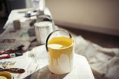 Yellow paint in paint can