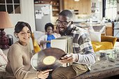 Couple looking at vinyl records in living room