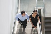 Business couple going up stairs of office building