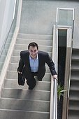 Businessman with briefcase on stairs of office building