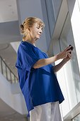 Nurse text messaging on her smartphone