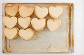 Stacks of Heart-Shaped Cookies on Baking Sheet, High Angle View