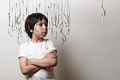 Boy Surrounded by Hanging Fish Hooks Looking at Cigarette on Fish Hook